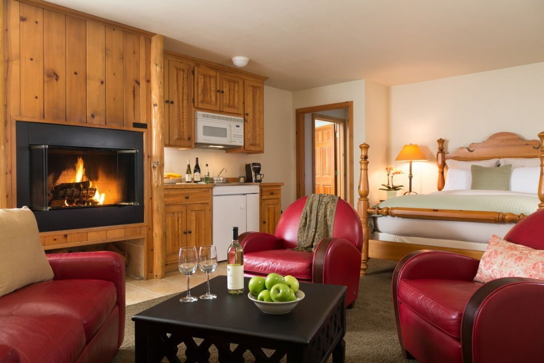 Suite 7 bedroom with fireplace at Sea Rock Inn