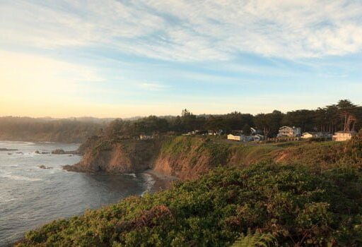 view over cliffs down to the ocean in California