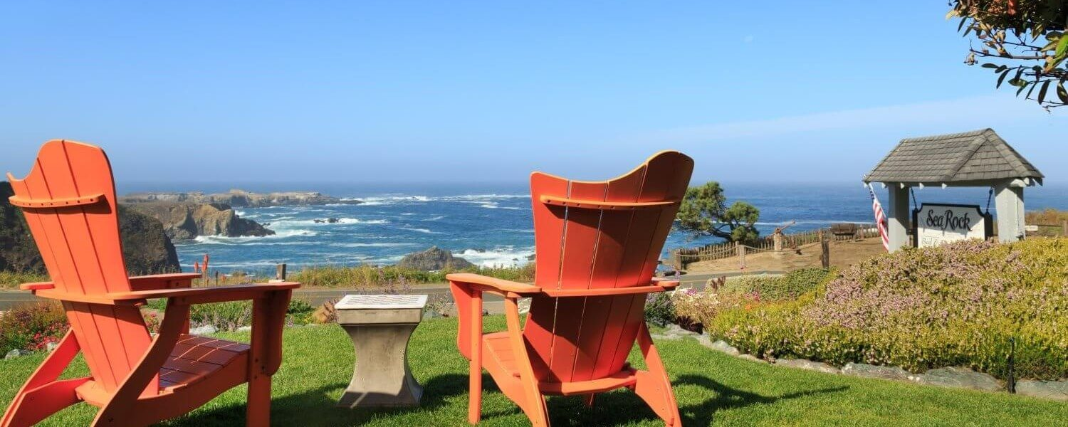 Adirondack chairs overlooking the ocean at Sea Rock Inn
