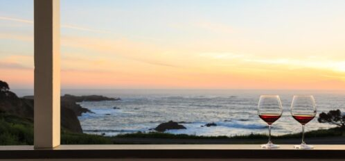 Honeymoon in Mendocino | view from private deck with glass of wine overlooking the ocean at sunset