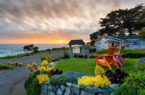 View of the property facing the ocean under orange sky