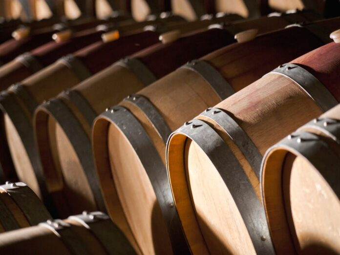 Toulouse Vineyards Wine barrels stacked in the old cellar of the winery.
