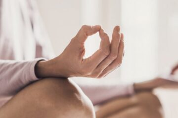 Woman meditating at yoga class