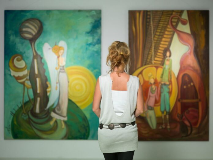 Woman visiting an art gallery and looking at a painting | Highlight Gallery Mendocino